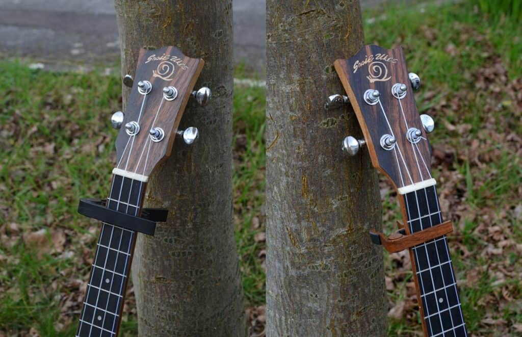guitar and ukulele capos, side by side