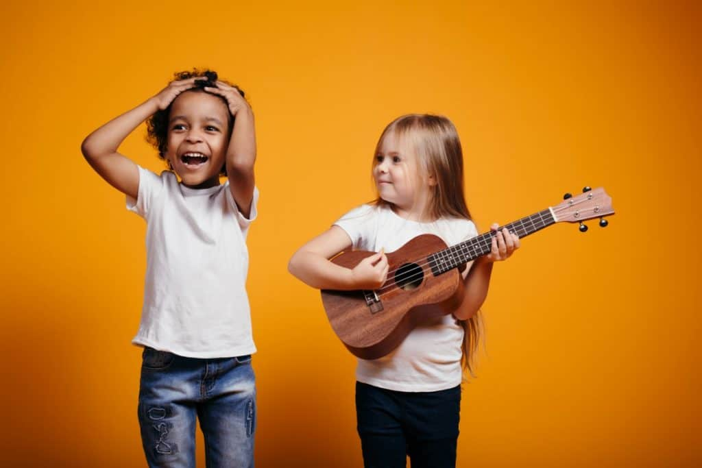 kids playing the ukulele