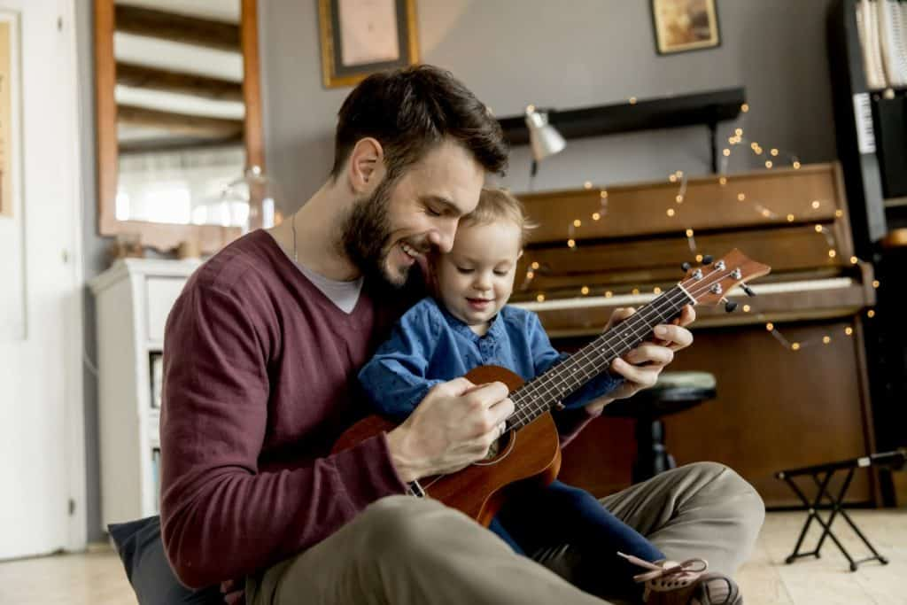 dad teaching son ukulele